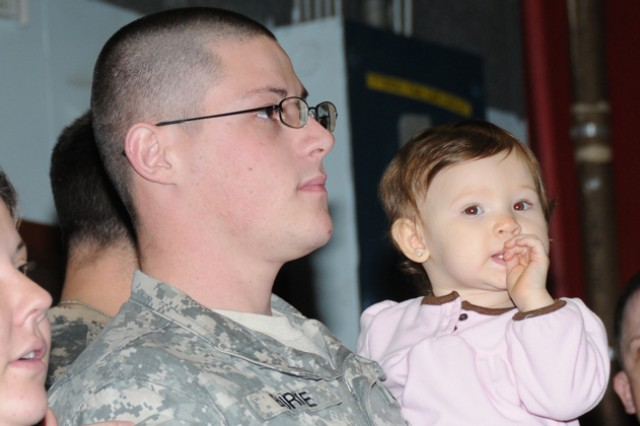 Sgt. Timothy Burke, 597th Maintenance Detachment, stands with his daughter, Desirae, during a farewell ceremony at Knox Army Heliport Feb. 25. Nine Soldiers of the 597th Maintenance Detachment deployed to support operations in air traffic services maintenance for airfield operations in Southwest Asia.