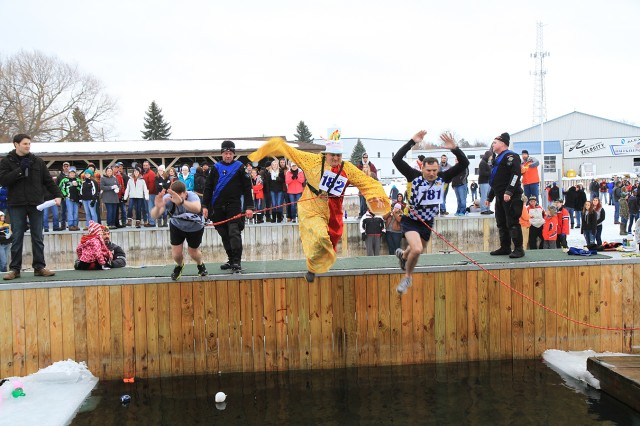 From left, Maj. Eric Kjonnerod, 1st Sgt. Ivan Barker and Lt. Col. Ronald Dicks, all leaders within 4th Battalion, 31st Infantry Regiment, 2nd Brigade Combat Team, jump into the frigid waters of the St. Lawrence River during the 23rd Annual Polar Bear Dip on Saturday at Bonnie Castle Resort in Alexandria Bay. The Friends of River Hospital host the annual event to raise money for medical equipment for the hospital. This year, proceeds will purchase a portable ultrasound machine for the emergency department.