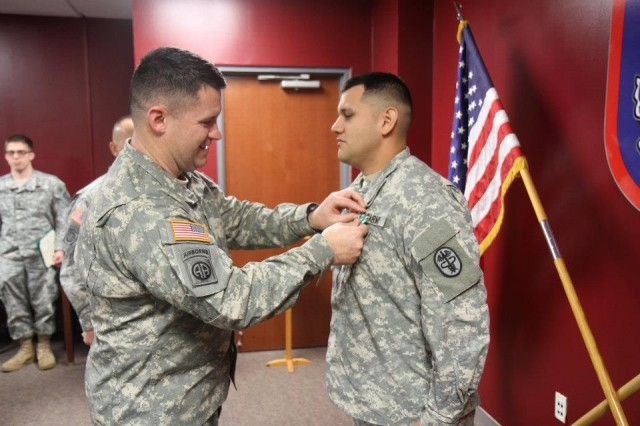 On February 21, 2013, Col. Michael  Fenzel, commander 3rd Brigade Combat Team, 82nd Airborne Division, presented Sgt. Luis X. Herrera, a Licensed Practical Nurse with Company C, Womack Army Medical Center, an Army Commendation Medal for preserving the life of a 3rd BCT paratrooper (photo by: Maj. Loren Bymer, 3rd BCT, 82nd ABN DIV, PAO)