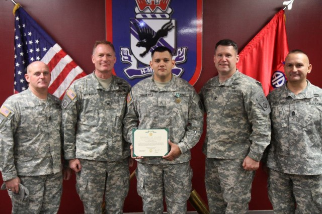 From left: Command Sgt. Maj. Michael Brooks, command sergeant major of Womack Army Medical Center, Col. Steven Brewster, commander of WAMC, Sgt. Luis Herrera, Licensed Practical Nurse at WAMC, Col. Michael Fenzel, commander 3rd Brigade Combat Team, 82nd Airborne Division and Command Sgt. Maj. Nicholas Rolling, command sergeant major of 3rd BCT, participate in the awarding of an Army Commendation Medal on February 21, 2012 to Herrera for his actions in preserving the life of a 3rd BCT paratrooper. (photo by: Maj. Loren Bymer, 3rd BCT, 82nd ABN DIV, PAO.)