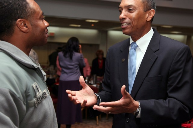 Retired. Col. Albert Johnson Jr. (right), Cameron University vice president for university advancement, speaks to a Soldier after the installation's annual Black History Month observance Feb. 21 at the Patriot Club. Johnson, the guest speaker, talked about prominent blacks and extraordinary citizens and how they led to social reform.