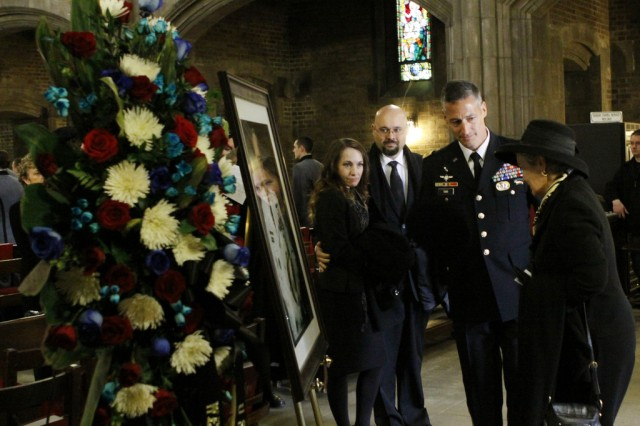 Brenda Schwarzkopf looks at a portrait of her late husband during the memorial service for retired Gen. H. Norman Schwarzkopf, in the Cadet Chapel, Feb. 28, 2013, at West Point, N.Y.