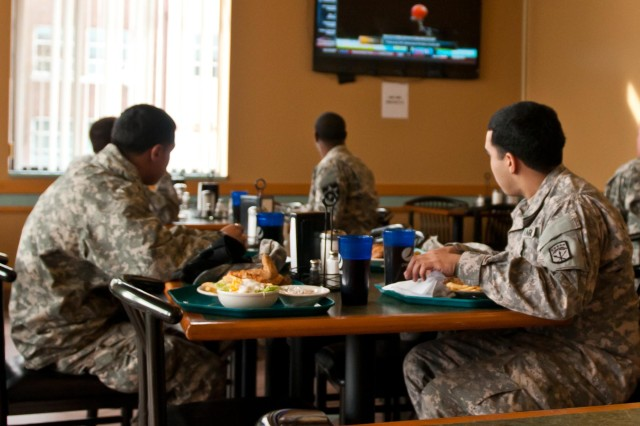 Joint Base Lewis-McChord, Wash.--Soldiers order lunch at the 593rd Sustainment Brigade, Eric G. Gibson Memorial Dining Facility, Joint Base Lewis-McChord, Wash., Feb. 20.  The dining facility is scheduled to close and merge with the 2nd Brigade, 2nd Infantry Division, Lancer Consolidated Dining Facility, which is located in building 11571 behind the Shoppette on JBLM-North, April 30. (U.S. Army photo by Sgt. Sarah E. Enos, 5th Mobile Public Affairs Detachment))