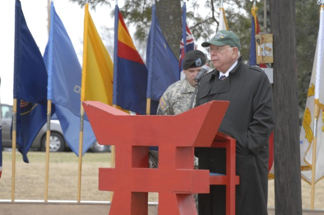Irving Weinsoff, president of the 187th National Rakkasan Association, speaks about the history and the fallen Rakkasans of the 187th Infantry Regiment, 3rd Brigade Combat Team, 101st Airborne Division (Air Assault) during an activation ceremony Feb. 20 at Fort Campbell, Ky. The ceremony celebrated the regiment's 70th anniversary since its activation in 1943 by honoring its long and valorous combat history and all of the fallen Rakkasans, whose names are inscribed on the pylons that stand in front of them. (U.S. Army photo taken by Sgt. Alan Graziano, 3rd Brigade Combat Team, 101st Airborne Division (Air Assault))
