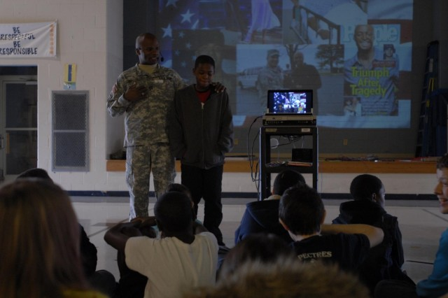 "Capt. Duwayne Ruffin, Rear-Detachment commander of the 626th Brigade Support Battalion, 3rd Brigade Combat Team ""Rakkasans,"" 101st Airborne Division (Air Assault), educates fifth graders Feb. 22 at Liberty Elementary School in Clarksville, Tenn., about famous black soldiers who have served in the division. Ruffin taught the class because February has been designated as Black History Month and his unit has been assigned to Liberty Elementary through the Army's Adopt a School Program. (U.S. Army photo taken by Sgt. Alan Graziano, 3rd Brigade Combat Team, 101st Airborne Division)"