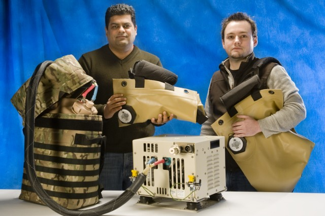 Shubham Chandra (left) and Ben Williams of the Natick Soldier Research, Development and Engineering Center's Systems Equipment and Engineering Team, Department of Defense Combat Feeding Directorate, have developed a system to provide cold and hot water to Soldiers in the field and keep it that way for days.