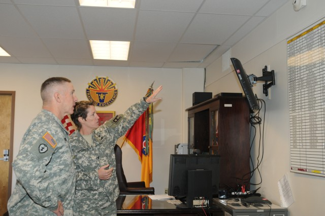 Col. Carolyn Birchfield (right), 402nd Field Artillery Brigade commander, briefs First Army's Commanding General, Lt. General J. Michael Bednarek, on the brigade's training missions during his visit Nov. 6, 2012.