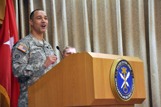 "Colonel Robert L. Edmonson II, G6, U.S. Army Intelligence and Security Command, speaks to an audience of attendees at the INSCOM and 1st Information Operations Command (Land) Equal Opportunity and Equal Employment Opportunity African American History Month celebration, Feb. 25, at Fort Belvoir, Va. The event, titled ""At the Crossroads,"" highlighted the achievements of African Americans throughout our Nation's history and the decisive choices Americans have faced as it relates to racial equality. (U.S. Army photo by Sgt. Jesus J. Aranda, U.S. Army Intelligence and Security Command public affairs office)"