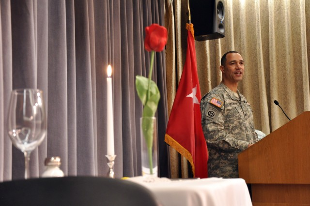 Colonel Robert L. Edmonson II, G6, U.S. Army Intelligence and Security Command, speaks to an audience of attendees at the INSCOM and 1st Information Operations Command (Land) Equal Opportunity and Equal Employment Opportunity African American History Month celebration, Feb. 25, at Fort Belvoir, Va. A special table is set up at the forefront of the ceremony to honor the sacrifice and memory of fallen heroes of the U.S. military throughout our history. (U.S. Army photo by Sgt. Jesus J. Aranda, U.S. Army Intelligence and Security Command public affairs office)