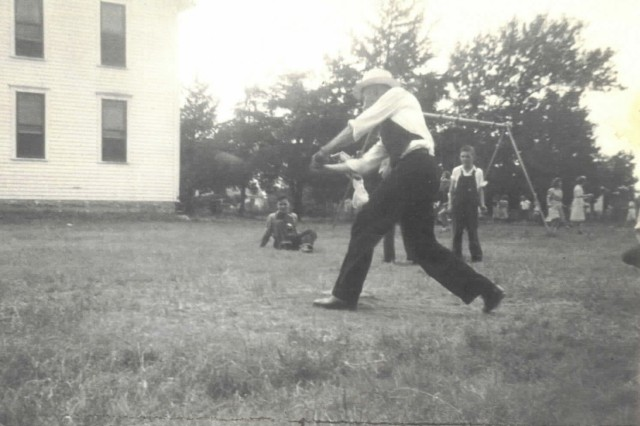 Kapaun playing baseball with school children
