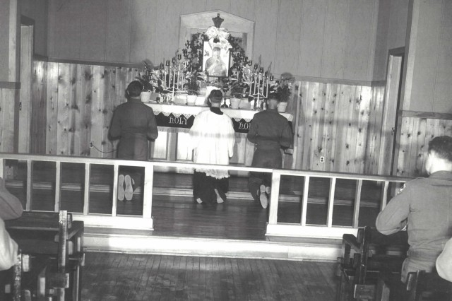 Emil Kapaun celebrates Mass for Soldiers at Herington Air Base, Kan., circa 1942.  It was after Father Kapaun saw the need for military chaplains while serving at the Herington Air Base that he felt the call to the military chaplaincy.