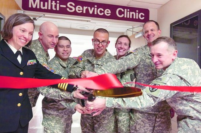 Col. Danny B.N. Jaghab, (center) commander, U.S. Army Medical Department, Fort Meade, and commander of Kimbrough Ambulatory Care Center cuts the ribbon marking the official opening of Kimbrough's new Multi-Service Clinic on Monday. He was joined by: Navy Capt. Patricia McKay, director of the hand and upper extremity clinic; Lt. Col. Andrew Baxter, assistant deputy commander for nursing; Sgt. Antoni Alatorre, noncommissioned officer-in-charge of the Multi-Service Clinic; Capt. Gayle Fisher, clinical nurse officer-in-charge of the Multi-Service Clinic; Maj. Jeff Van Den Broek, officer-in-charge of the Multi-Service Clinic; and Col. Leon Moores, a former Kimbrough commander and now special assistant to the president at the Uniformed Services University of the Health Sciences.
