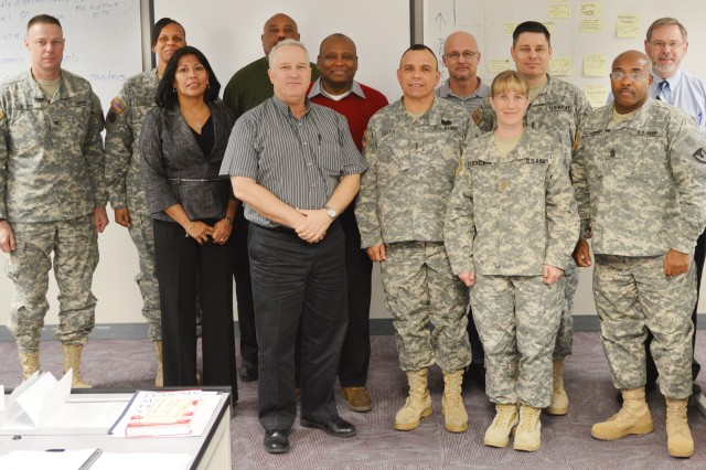 Soldiers and civilian personnel of the 407th AFSB attending the Lean Six Sigma Project Identification and Selection Workshop gather for a group photograph.
