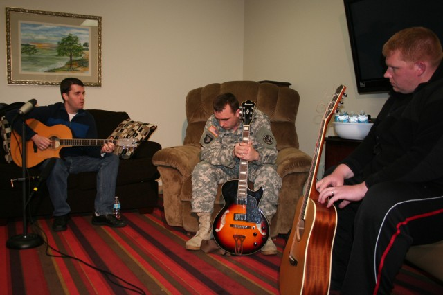 "Nashville singer/songwriter JP Williams (left) holds a songwriting session Feb. 12 with five Fort Campbell Warrior Transition Battalion Soldiers at the post Soldier and Family Assistance Center. Spc. Derek Leach and Sgt. Jeremy Smith brainstorm ways to put their combat experience into lyrics for their song ""Green."""