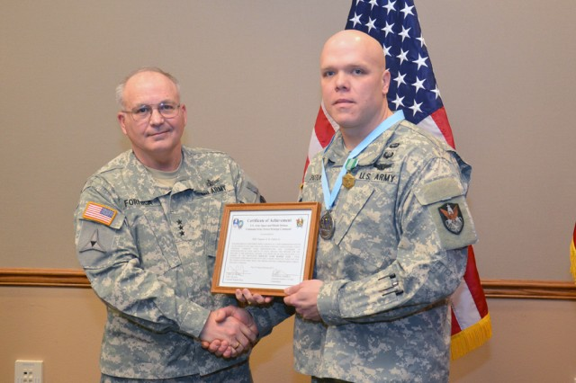 Lt. Gen. Richard P. Formica, commanding general, U.S. Army Space and Missile Defense Command/Army Forces Strategic Command, inducts Staff Sgt. Eugene A.K. Patton Jr., readiness noncommissioned officer, 117th Space Battalion (Colorado Army National Guard), 1st Space Brigade, into the SMDC local chapter of the Sergeant Audie Murphy Club Feb. 27.