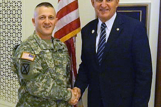 U.S. Senator Joe Manchin (D-WV) greets U.S. Army Major Richard Ojeda as he arrives at the Senator's office prior to the State of the Union event.