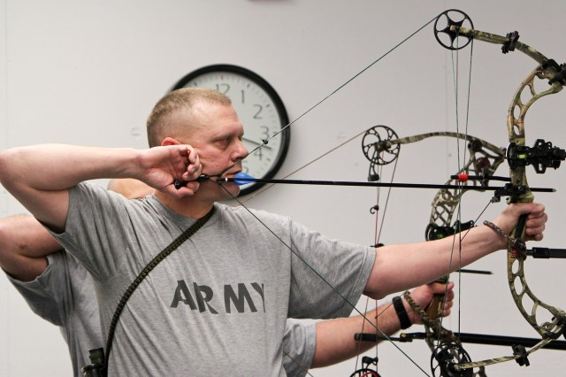 Staff Sgt. Sean Stephenson, Warrior Transition Unit, Joint Base Lewis-McChord, Wash., practices aiming his compound bow during the 2013 Warrior Games Archery and Sitting Volleyball Trials, held on Fort Belvoir, Va., from Feb. 25 to March 1, 2013. Athletes are competing to represent the Army during the 2013 Warrior Games.