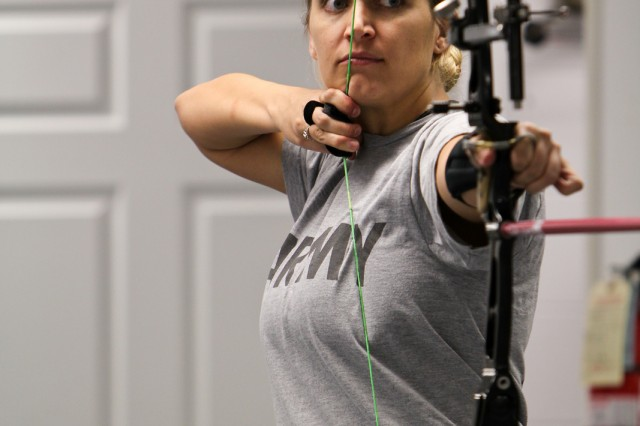 Staff Sgt. Meggan Youngblood, assigned to Community Based Warrior Transition Unit-Utah, practices sighting during archery practice at the 2013 Warrior Games Archery and Sitting Volleyball Trials. The trials were held on Fort Belvoir, Va., from Feb. 25 to March 1, 2013.