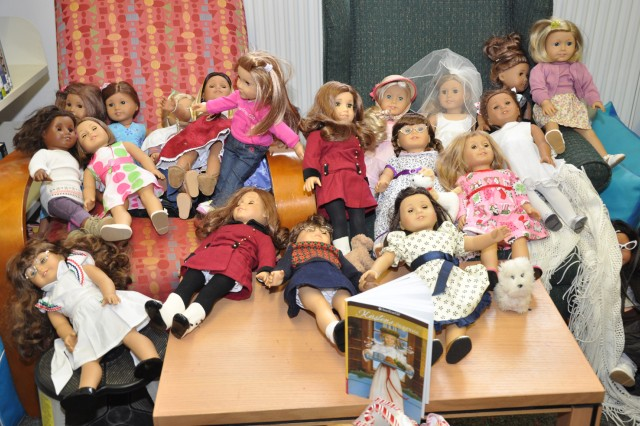 "Girls display their ""American Girl"" dolls at the Wiesbaden Library."