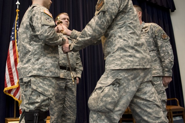 Command Sgt. Maj. Robert Beausoleil, left, receives the NCO Sword from Lt. Col. (P) Frank Sobchak, garrison commander, during his March 4 assumption of responsibility ceremony at U.S. Army Garrison Natick.