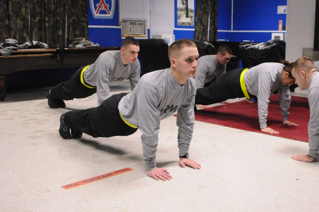 "Soldiers in Warrior Leader Course Class 05-13 ""cool down"" after morning physical training.  Class 05-13 is the first to complete the Army's new WLC curriculum, which includes passing the Army Physcial Fitness Test to graduate from the course."