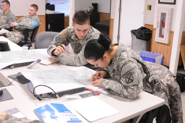 Sgt. Daniel J. Beckner and Spc. Stephanie R. Vazqez practice map reading. Another new requirement in the WLC curriculum is land navigation.