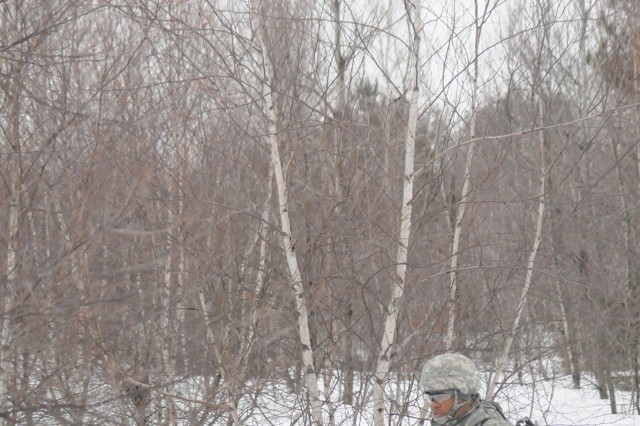 Spc. Jonathan Robinson scans the perimeter during an exercise Thursday on Fort Drum.