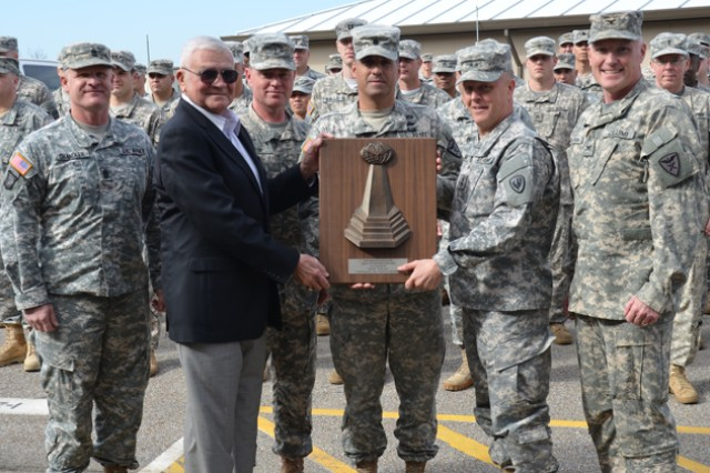 Maj. Gen. Kevin W. Mangum, USAACE and Fort Rucker commanding general, and retired Lt. Gen. Ellis D. Parker present a Parker Award, named for the retired Aviator, to Lt. Col. Demetrios Nicholson, 1st Bn., 223rd AVN commander, along with 110th Avn. Bde. Command Sgt. Maj. John L. Chandler (left), CW5 Michael L. Reese, Chief Warrant Officer of the Aviation Branch, Col. Kevin J. Christensen, 110th Avn. Bde. commander, and members of the 1st Bn., 223rd Avn.