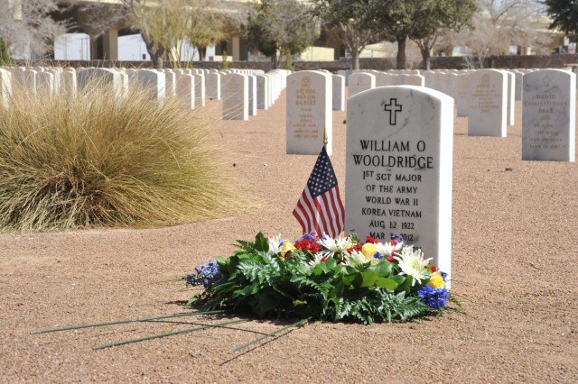 A wreath lays on the grave of William O. Wooldridge, the first sergeant major of the Army, to honor his life one year after his death. U.S. Army Sergeants Major Academy staff held an informal ceremony March 5 at the Fort Bliss National Cemetery to remember his passing. Wooldridge's gravestone is located near the main entrance of the cemetery.