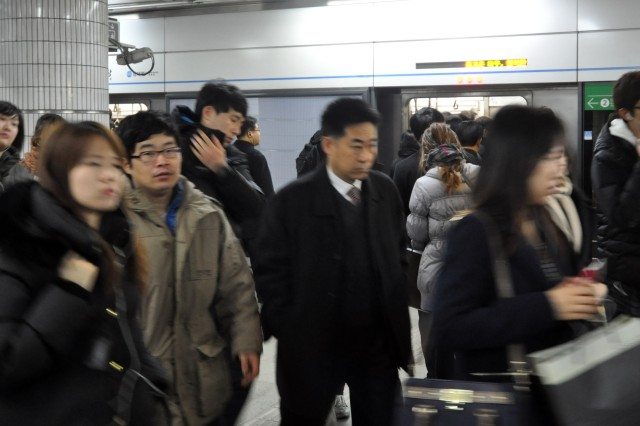 People take small steps at crowded Sadang subway station in the morning to go to work. Sadang station connects 4th and 2nd subway line which are two of the most used lines in Korean subway system, 28. Feb. (U.S. Army photo by Sgt. Kevin Frazier)