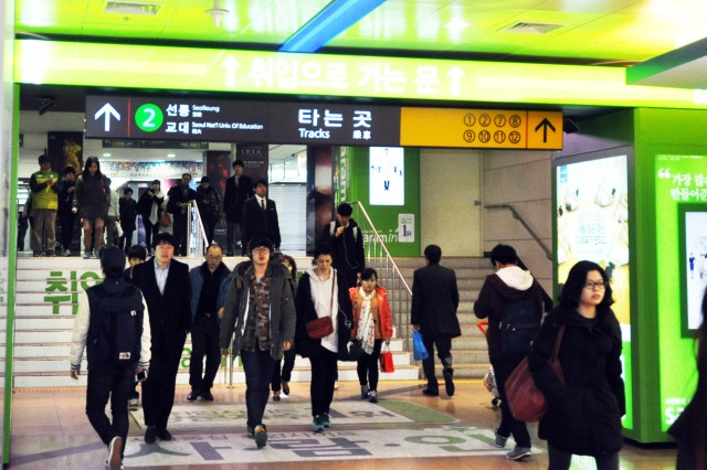 People take small steps at crowded Gangnam subway station in the morning to go to work. Gangnam subway station is located in the middle of Gangnam district where many hang around places are nearby, 28. Feb. (U.S. Army photo by Sgt. Kevin Frazier)