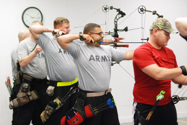 Warrior Transition Battalion Soldiers compete in a Warrior Games archery qualifying event, Feb. 27, 2013, at the Outdoor Recreation Indoor Archery Range at Fort Belvoir, Va.