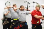 Army Warrior Games athletes compete during archery, sitting volleyball trials