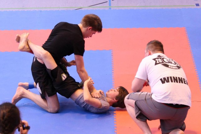 "Charlie Spond (bottom) grapples against a much bigger opponent in what HBJJ instructor Jeremy Workman called ""the fight of the night"" at the Bavaria Cup in Ansbach, recently."