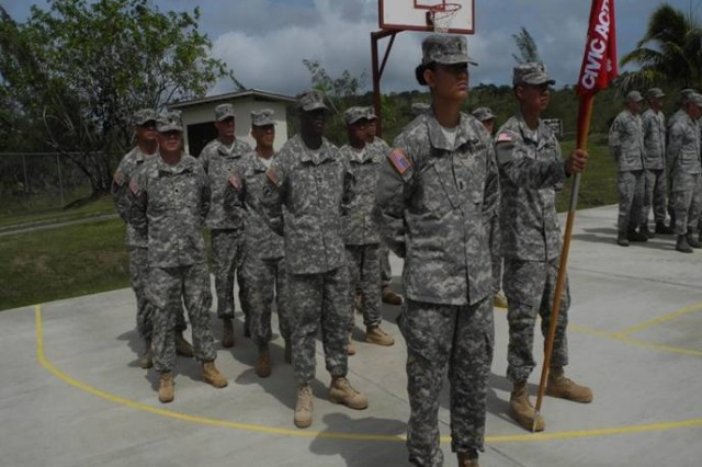 1st Lt. Danielle Monroe, 643rd Engineer Company, 84th Engineer Battalion, 130th Engineer Brigade, 8th Theater Sustainment Command, stands in front of the Civil Action Team formation at the turnover ceremony, on the island of Palau, Feb 15, 2013.