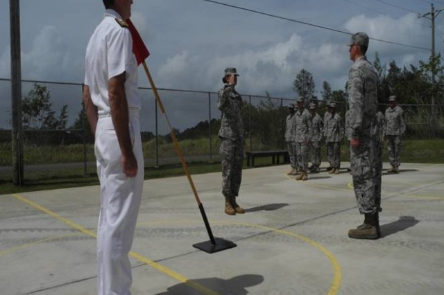 First Lt. Danielle Monroe, 643rd Engineer Company, 84th Engineer Battalion, 130th Engineer Brigade, 8th Theater Sustainment Command, assumes the duties as officer in charge of Camp Katuu from the Air Force Civil Action Team, Palau, Feb 15, 2013.