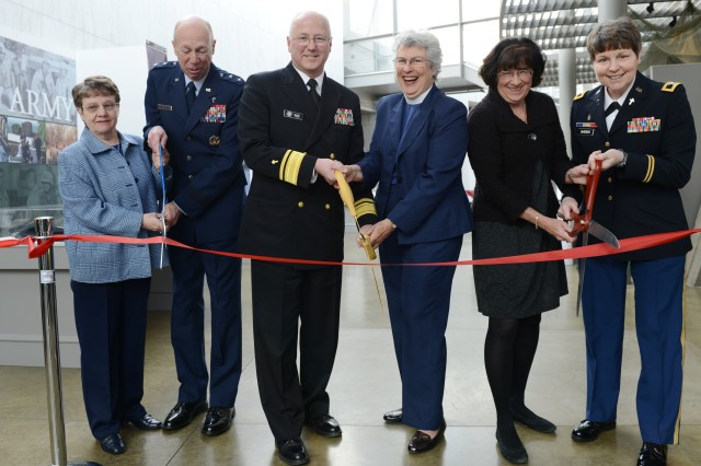 """(left to right) Retired Maj. Gen. Lorraine K. Potter, former U.S. Air force chaplain; Air Force Maj. Gen. Howard D. Stendahl, Air Force chief of Chaplains; Rear Adm. Mark L. Tidd, Navy chief of Chaplains; Reverend Dianna P. Bell, the first woman military chaplain; Janet Horton, U.S. Army retired chaplain; and Col. Barbara Sherer, the United States Military Academy's command chaplain, open a new exhibit, themed """"Celebrating 40 Years of Women Chaplains: A Courageous Journey of Faith and Service.""""  The exhibit is at the Women in Military Service For America Memorial, Arlington Nation Cemetery, Arlington, Va., March 4, 2013."""