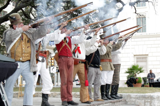 """SAN ANTONIO """" Members of the San Antonio Living History Association honor guard fire a flintlock volley March 6 during an annual memorial service to honor the heroes of the Alamo at the Cenotaph in Alamo Plaza."""
