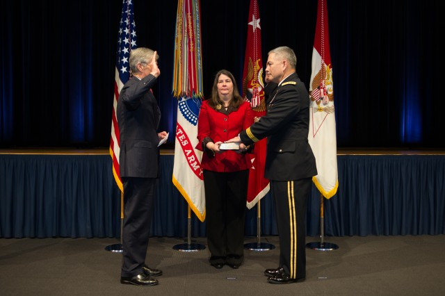 Secretary of the Army John McHugh swears-in Gen. John Campbell as the 34th Army Vice Chief of Staff during a ceremony at the Pentagon Auditorium Mar. 8, 2013 in the Pentagon, Va. Ann Campbell, Gen. Campbell's spouse, was holding the bible.