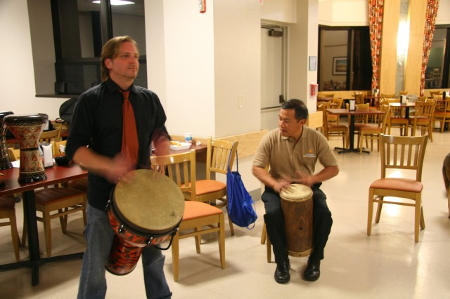 The Pacific Regional Medical Command's Care Provider Support Program, Richard Ries (left) and Howard Reyes (right), demonstrate an alternative and creative approach to reaching wellness through music during a resiliency training session held at Tripler Army Medical Center, May 4, 2012. TAMC is one of four organizations within North American that were recognized with the top Psychologically Healthy Workplace Award for 2013.