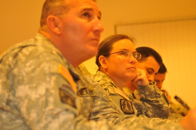 Col. Kimberly Rapacz (center), who heads the U.S. Army Pacific Command Inspector General's office, listens to IG representatives from across USARPAC during a round table discussion during an IG Workshop at the Aliamanu Community Center Feb. 25.