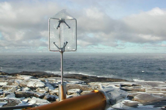 A cloud imaging probe with sonic anemometer sits on the lighthouse foghorn platform; it is used to measure sea spray.