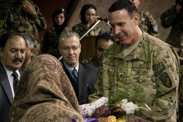Brig. Gen. Steven M. Shepro, commanding general, NATO Air Training Command Afghanistan, speaks with one of the many women who were honored during an International Women's Day celebration at Kabul International Airport, Afghanistan, March 7, 2013. The celebration highlighted the contributions Afghan women make toward building a better and stronger Afghan Air Force.