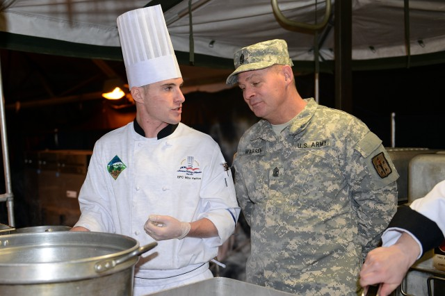 Spc. Mike Hatton meets with Sgt. Maj. Mark W. Warren, of the Joint Culinary Center of Excellence, during the 2013 Armed Services Culinary Arts Competition at Fort Lee, Va.