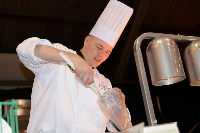 Staff Sgt. James Rush, of Fort Carson, Colo., fills a piping bag with purple Peruvian potatoes during the 2013 Armed Services Culinary Arts Competition at Fort Lee, Va.