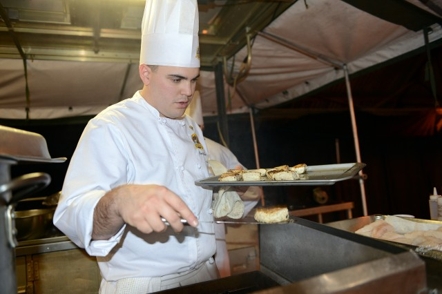 Spc. Thomas Poux, from Fort Hood, Texas, prepares halibut during the 2013 Armed Services Culinary Arts Competition at Fort Lee, Va.