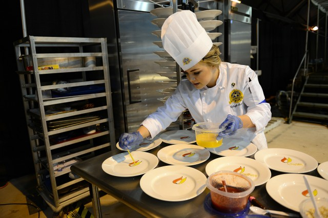 Spc. Caleigh Arrington, from Fort Hood, Texas, prepares a desert at the 2013 Armed Services Culinary Arts Competition at Fort Lee, Va.