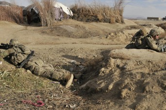 Soldiers with Bravo Company, 2nd Battalion, 23rd Infantry Regiment provide security outside an Afghan village March 3 during Operation Southern Fist III in the district of Spin Boldak, Kandahar province, Afghanistan. The unit assisted Afghan Border P...