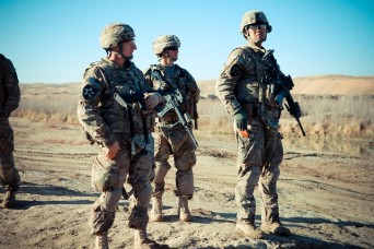U.S. Army Lt. Col. Kenneth Sheidt, 1st Lt. Kristopher Buchanan and Staff Sgt. George Tan, all with Security Force Assistance Team 10, 4th Stryker Brigade Combat Team, 2nd Infantry Division, observe operations while on patrol in Kandahar province, Afg...