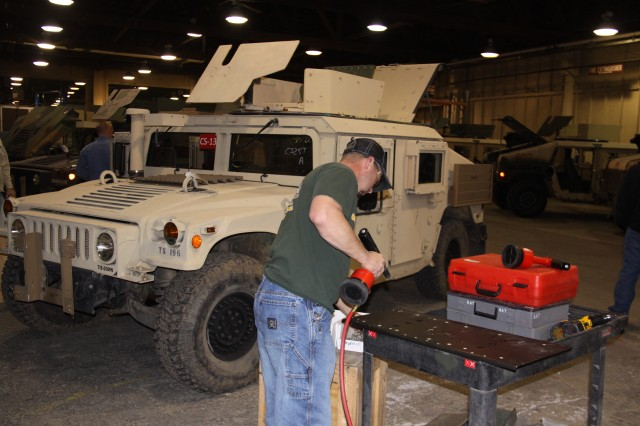 A technician at Red River Army Depot, Texas, prepares a Capability Set 13 training set Humvee to be integrated with network equipment. The quick-reaction project to complete more than 330 Humvees reflects a strong partnership between the Assistant Secretary of the Army for Acquisition, Logistics and Technology and Army Materiel Command, to leverage expertise across both communities and deliver a needed capability to support Operation Enduring Freedom.